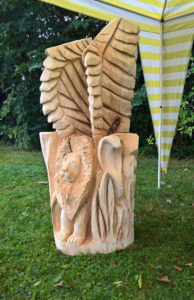 Řezba alegorie - okřídlený lev, had a sova